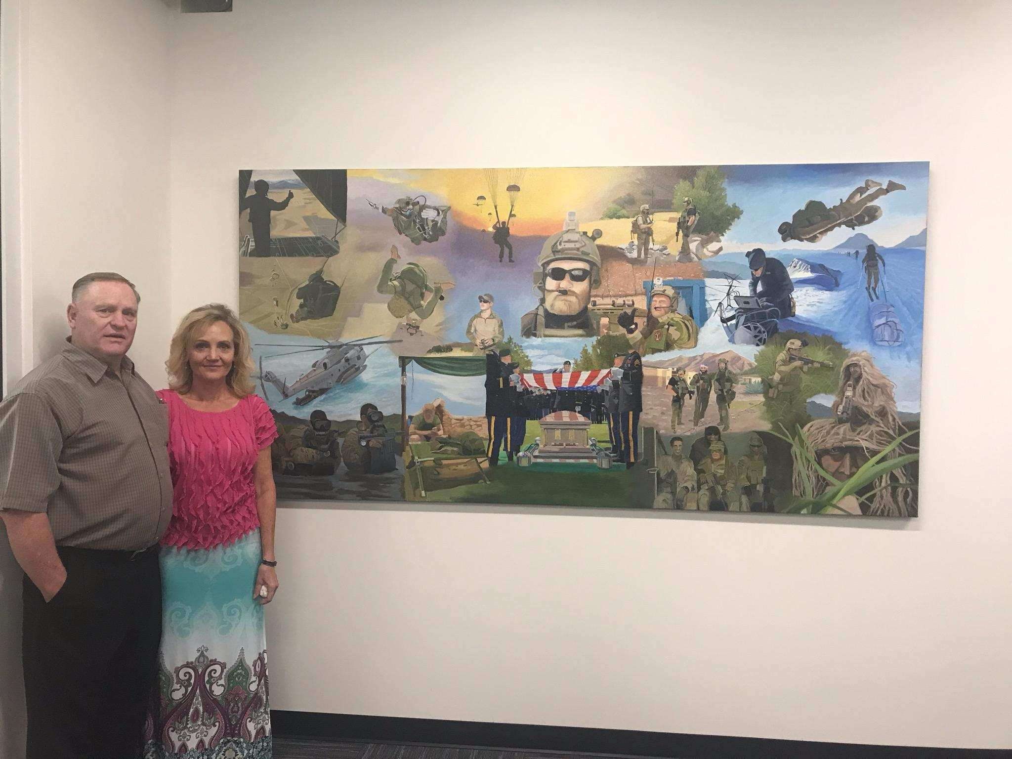 Randy and Laura Butler at the entrance to the SSG Aaron R. Butler Readiness Center at Camp Williams.Courtesy photo