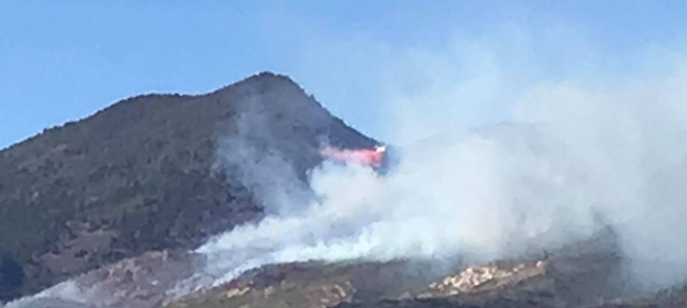 Photo by Kelly Mike Green, flames on the south mountain in La Sal puts smoke into the area
